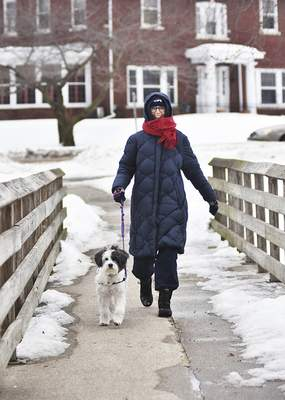 Katie Fyfe | The Journal Gazette Peggy Toliver walks her 8-year-old Tibetan terrier, Pema, through Lakeside Park on Monday afternoon.