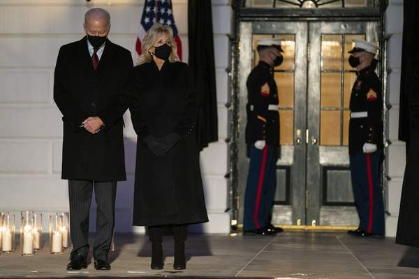 Associated Press President Joe Biden and first lady Jill Biden observe a moment of silence Monday at the White House to honor the 500,000 American victims of COVID-19.