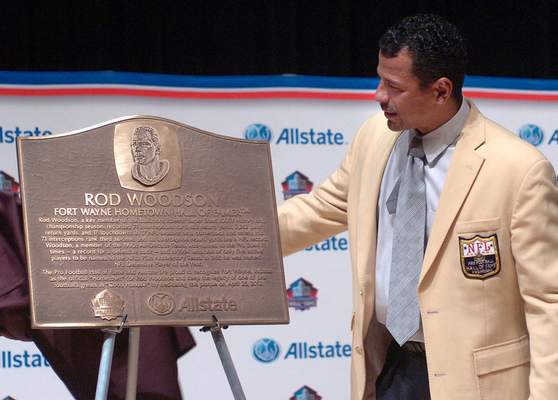 File NFL Hall of Famer and local football legend Rod Woodson admires his Hometown Hall of Famer plaque at Snider High School in April 2012.