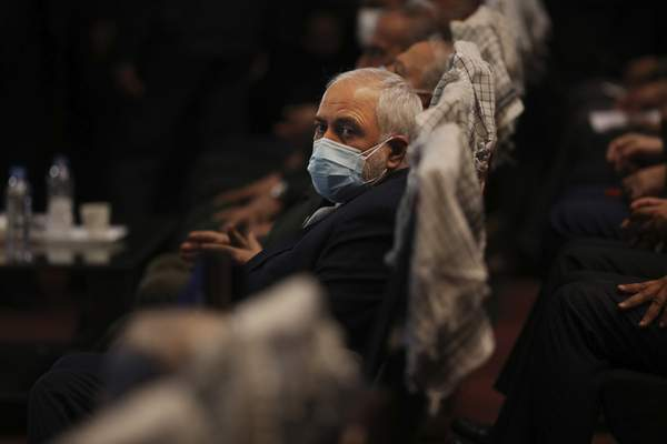 Iran's Foreign Minister Mohammad Javad Zarif attends a conference in Tehran, Iran, Tuesday, Feb. 23, 2021. Following the conference Zarif told journalists the country has started implementing a law passed by the parliament to curb UN inspections into its nuclear program and would no longer share surveillance footage of its nuclear facilities with the U.N. agency. (AP Photo/Vahid Salemi)