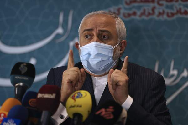 Iran's Foreign Minister Mohammad Javad Zarif speaks with journalists following a conference in Tehran, Iran, Tuesday, Feb. 23, 2021. Iran's foreign minister says the country has started implementing a law passed by the parliament to curb UN inspections into its nuclear program. Zarif reiterated that Iran would no longer share surveillance footage of its nuclear facilities with the U.N. agency. (AP Photo/Vahid Salemi)