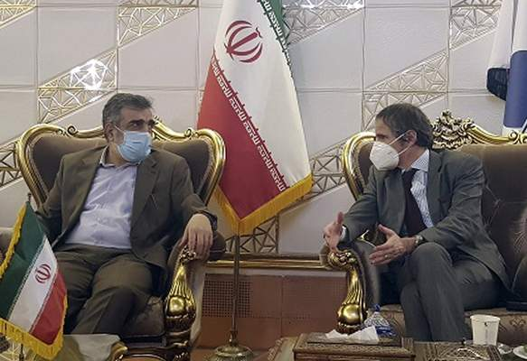FILE - In this Feb. 20, 2021, file photo, Director General of International Atomic Energy Agency, IAEA, Rafael Mariano Grossi, right, speaks with spokesman of Iran's atomic agency Behrouz Kamalvandi upon his arrival at Tehran's Imam Khomeini airport, Iran. Iran has said it plans to cease its implementation of the Additional Protocol, a confidential agreement between Tehran and the IAEA reached as part of the landmark nuclear accord that grants the U.N. inspectors enhanced powers to visit nuclear facilities and watch Iran's program. (Atomic Energy Organization of Iran via AP, File)