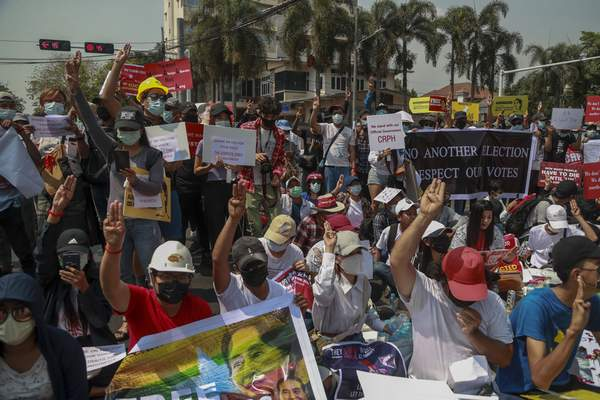 Demonstrators display placards during a protest close to Indonesian Embassy in Yangon, Myanmar, Tuesday, Feb. 23, 2021. (AP Photo)