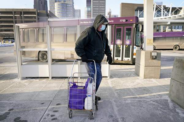 Associated Press photos Dave Lestina of Des Moines, Iowa, leaves a mobile food pantry stop after picking up a Farmers to Families Food Box on Thursday.