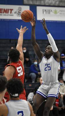 Mike Moore | The Journal Gazette Saint Francis forward David Ejah shoots the ball on Wednesday in the first half against Grace College at the Hutzell Athletic Center.