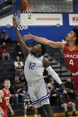 Mike Moore | The Journal Gazette Saint Francis guard Antwaan Cushingberry scores a layup on Wednesday in the first half against Grace College at the Hutzell Athletic Center.