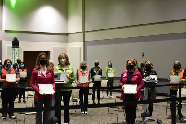 Katie Fyfe | The Journal Gazette      Parkview Healthemployees hold certificates of appreciation during a celebration of the 50,000 vaccination for COVID-19 on Wednesday, February, 24, 2021.