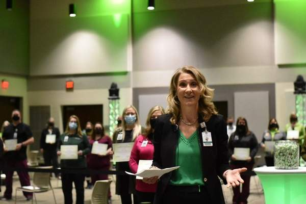 Katie Fyfe | The Journal Gazette      Chief Administrative Officer of Parkview Health Dena Jacquay celebrates the 50,000 vaccination for COVID-19 on Wednesday, February, 24, 2021.