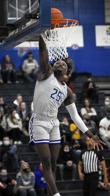 Mike Moore | The Journal Gazette Saint Francis forward David Ejah dunks the ball Wednesday in the first half against Grace College at the Hutzell Athletic Center.