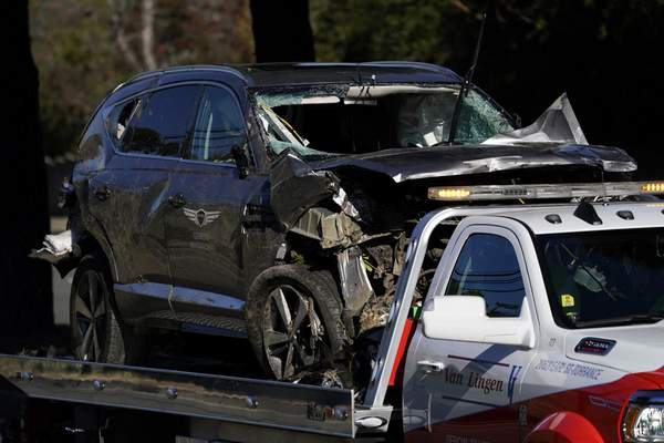 Associated Press The vehicle driven by Tiger Woods is towed away after a crash that severely hurt the golfer Tuesday in the Rancho Palos Verdes suburb of Los Angeles.