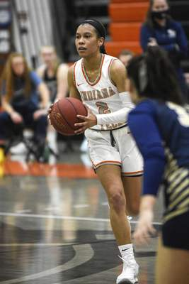 Mike Moore | The Journal Gazette Indiana Tech guard Taya Andrews looks to pass the ball in the third quarter against Cornerstone at the Schaefer Center on Thursday.