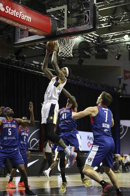 Courtesy Mad Ants/NBAE  Devin Robinson, middle, totaled 17 points, 15 rebounds and 2 shot blocks for the Mad Ants on Thursday as they defeated Long Island in Orlando, Florida.