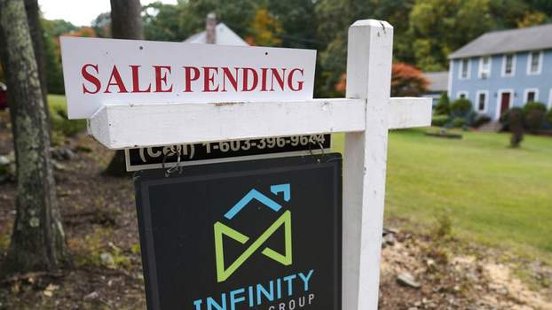 Pending Home Sales FILE - In this Sept. 29, 2020 file photo, a sale pending sign is displayed outside a residential home for sale in East Derry, N.H. (AP Photo/Charles Krupa, File) (Charles Krupa
