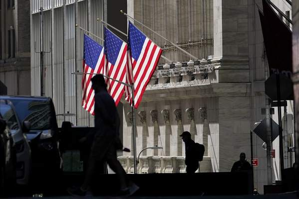FILE - In this Oct. 14, 2020 file photo, pedestrians pass the New York Stock Exchange in New York. (AP Photo/Frank Franklin II, File)