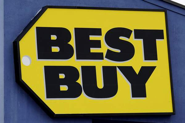 A Best Buy store sign is displayed in Arlington Heights, Ill., Saturday, Feb. 6, 2021. Best Buys is closing five stores in four states in the next month. (AP Photo/Nam Y. Huh)
