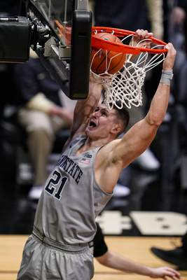 Penn State forward John Harrar (21) gets a dunk against Purdue during the first half of an NCAA college basketball game in West Lafayette, Ind., Sunday, Jan. 17, 2021. (AP Photo/Michael Conroy)