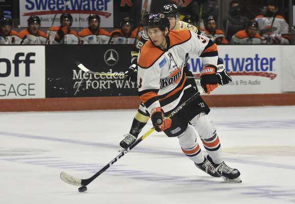 Katie Fyfe | The Journal Gazette Komets forward Jason Cotton carries the puck during the second period against Wheeling Nailers at Memorial Coliseum on Saturday.