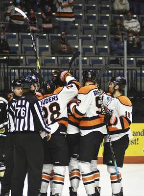 Katie Fyfe | The Journal Gazette The Komets celebrate after scoring a goal during the first period against Wheeling Nailers at Memorial Coliseum on Saturday.