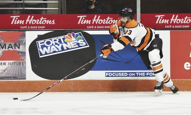 Katie Fyfe | The Journal Gazette  Komets forward Spencer Smallman chases the puck during the second period against Wheeling Nailers at Memorial Coliseum on Saturday.