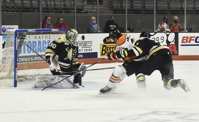Katie Fyfe | The Journal Gazette  Komets forward Spencer Smallman gets interfered with on a short handed breakaway by Wheeling Nailers defenseman Patrick McNally during the second period at Memorial Coliseum on Saturday.