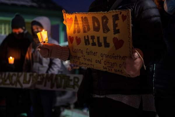 Associated Press In this Dec. 26 file photo, a vigil is held for Andre Hill at the Brentnell Community Recreation Center in Columbus, Ohio. Hill, who was black, was shot to death Dec. 22 by a white officer.