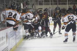 Courtesy Whiteshark Photography A melee breaks out in front of the Komets' bench, after Fort Wayne's Shawn Szydlowski checked the Indy Fuel's Joe Sullivan on Friday. (jj.kj wikman)