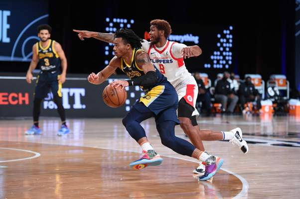 Courtesy Mad Ants/NBAE  The Mad Ants' Jalen Lecque, who had 11 points, drives past Agua Caliente's Tyrone Wallace in Orlando, Florida, where Naz Mitrou-Long, left, looks on Thursday.