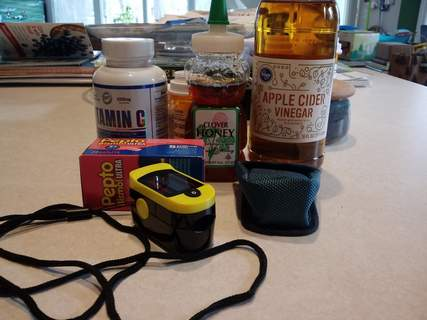 Sherry Slater | The Journal Gazette  Vitamin C, honey, apple cider vinegar, Pepto Bismol and a pulse oximeter were among the items recommended by friends, family and physicians during a bout with the coronavirus.