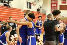 Saint Francis Athletics Saint Francis' Jalan Mull, right, and Jeffrey Reynolds embrace after Saturday's victory in Marion.