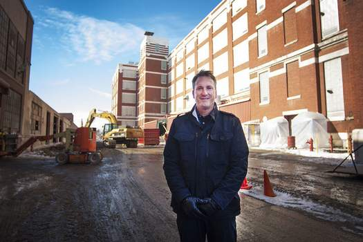 Katie Fyfe | The Journal Gazette Do it Best CEO Dan Starr poses at  the Electric Works campus, where the cooperative will move its headquarters.