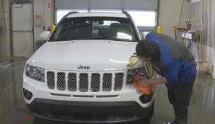 Rising Vehicle Prices Associated Press photos In this image made from video, a worker washes a Jeep inside the service department of an auto dealership in Fenton Township, Mich. A chain reaction touched off by the coronavirus pandemic has pushed up vehicle prices.  (Mike HouseholderSTF)