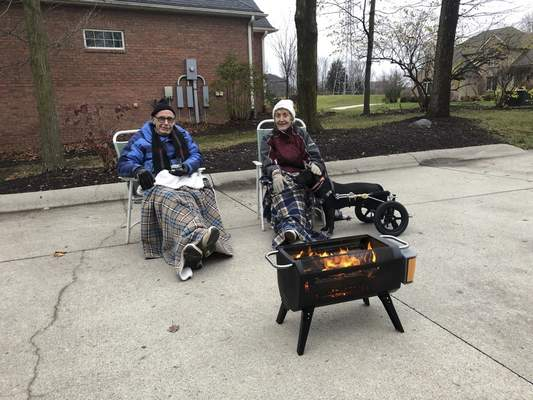 Karen Asp has been having weekly driveway drinks with her parents, Walt and Sue Asp, since the pandemic started. They even had them on Christmas Eve when temperatures were low.
