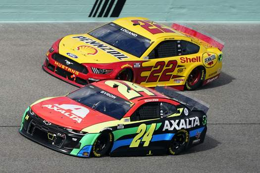 NASCAR Homestead Auto Racing Joey Logano (22) and William Byron (24) battle for position during a NASCAR Cup Series auto race, Sunday, Feb. 28, 2021, in Homestead, Fla. (AP Photo/Wilfredo Lee) (Wilfredo Lee STF)