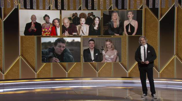 2021 Golden Globe Awards In this video grab issued Sunday, Feb. 28, 2021, by NBC, Joaquin Phoenix presents the award for best actress in a motion picture drama as the nominees appear on screen at the Golden Globe Awards. (NBC via AP) (NBC