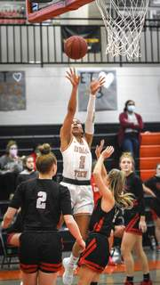 Mike Moore | The Journal Gazette Indiana Tech guard Taya Andrews takes a shot during the second quarter of Monday's game with Concordia. Andrews finished with 24 points.