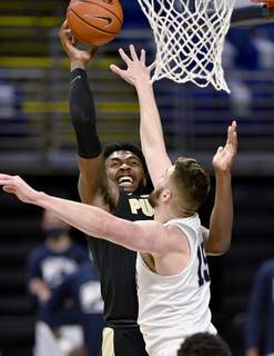 Purdue Penn St Basketball Associated Press Purdue's Trevion Williams shoots over Penn State's Trent Buttrick during Friday's game. Williams will battle Wisconsin's D'Mitrik Price tonight. (Abby DreyMBO)