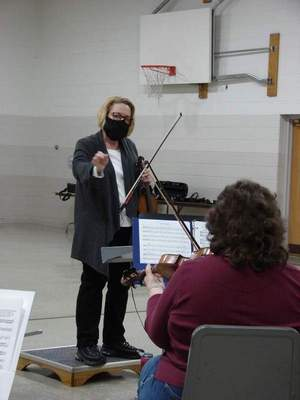 Debra Graham, founder of the Fort Wayne Terrible Orchestra, conducts the musicians. They meet each Monday for 10 weeks.