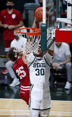 Michigan State's Marcus Bingham Jr. (30) goes up for a shot and draws a foul against Indiana's Trey Galloway (25) during the first half of an NCAA college basketball game, Tuesday, March 2, 2021, in East Lansing, Mich. (AP Photo/Al Goldis)