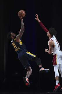 Courtesy Mad Ants/NBAE  The Mad Ants' Oshae Brissett, left, shoots in Orlando, Florida, Thursday as he's defended by Canton's Brodric Thomas. (Juan Ocampo Contributor)