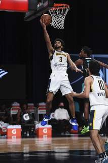 Courtesy Mad Ants/NBAE  Mad Ants guard Naz Mitrou-Long goes up for abasket against the Greensboro Swarm on Friday in Orlando, Florida, where Mitrou-Long had a triple-double in the final game of the season. (Juan OcampoContributor)