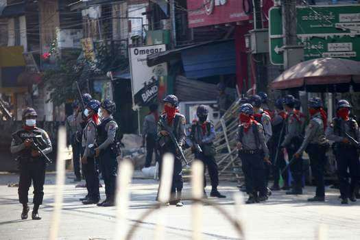 Myanmar Armed police stand guard on a major street to preven anti-coup demonstration in Yangon, Myanmar, Friday, March 5, 2021. Footage of a brutal crackdown on protests against a coup in Myanmar has unleashed outrage and calls for a stronger international response. (AP Photo) (STR STR)