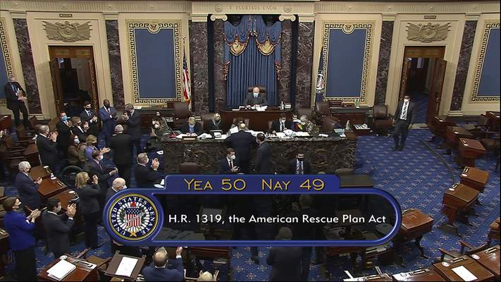 In this image from video, the vote total of 50-49 on Senate passage of the COVID-19 relief bill, is displayed on screen in the Senate at the U.S. Capitol in Washington, Saturday, March 6, 2021. (Senate Television via AP)