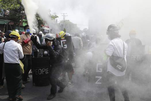 Myanmar Anti-coup protesters discharge fire extinguishers to counter the impact of the tear gas fired by police during a demonstration in Mandalay, Myanmar, Sunday, March 7, 2021. (AP Photo) (STR)