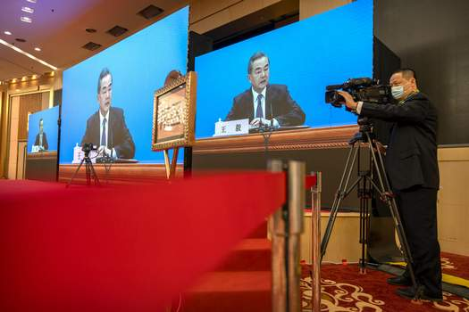 China Congress Chinese Foreign Minister Wang Yi speaks during a remote video press conference held on the sidelines of the annual meeting of China's National People's Congress (NPC) in Beijing, Sunday, March 7, 2021. (AP Photo/Mark Schiefelbein) (Mark Schiefelbein STF)