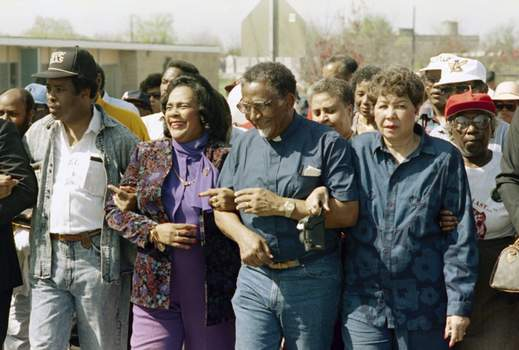 Racial Injustice Selma FILE - In this March 4, 1990, file photo, Coretta Scott King walks arm-in-arm with Southern Christian Leadership Conference President Joseph Lowery, second from right, in Selma, Ala., as marchers begin the final leg of their trek to the Alabama Capitol. (AP Photo/Dave Martin, File) (Dave Martin STF)