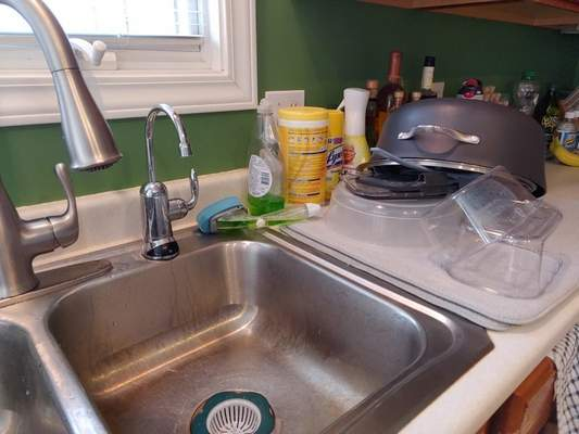 Sherry Slater | The Journal Gazette  Freshly washed dishes sit drying beside the sink in Sherry Slater's kitchen. Her husband gets credit for doing the chore.