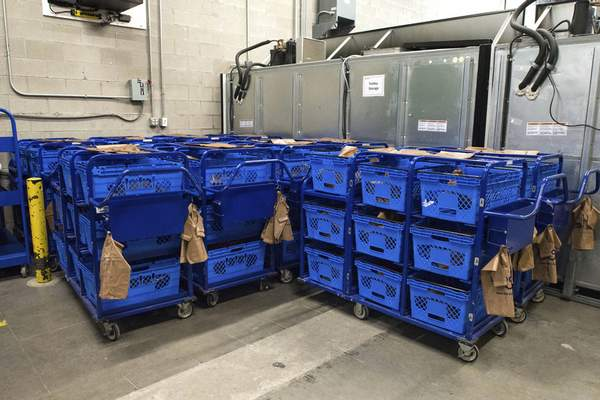 Michelle Davies   The Journal Gazette Trollies prepped and waiting to be used for curbside grocery orders at Kroger.