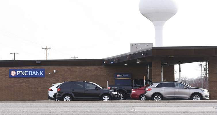 Katie Fyfe   The Journal Gazette  PNC customers go through the drive-thru of the PNC located off of Dupont Road on Tuesday, March 9th, 2021.PNC Bank's annual surveyof midsized and small business owners also found respondents optimistic about an economic recovery in 2021.