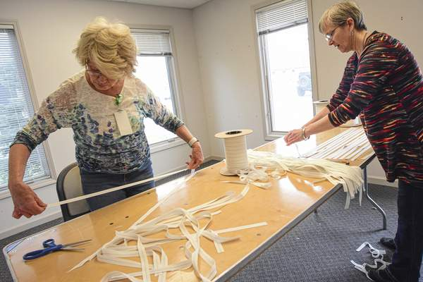 Mike Moore   The Journal Gazette Workers of Parkview Regional Medical Center work together to make medical mask kits on Wednesday 03.25.20