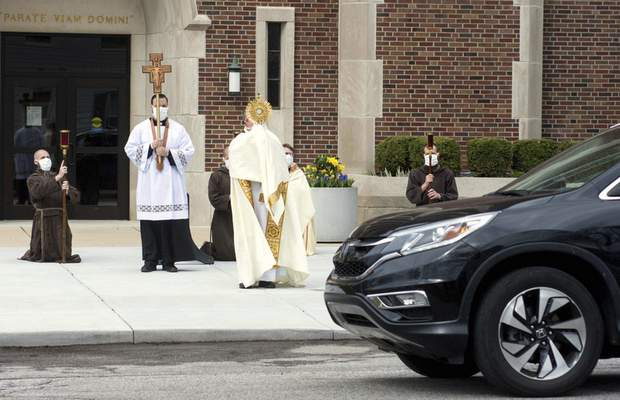 Michelle Davies   The Journal Gazette  On Easter Sunday last year, the Rev. Andrew Budzinski leads a Eucharistic procession. The event took place with the permission of  Bishop Kevin C. Rhoades, and the guidance of the Allen County and Indiana departments of health.
